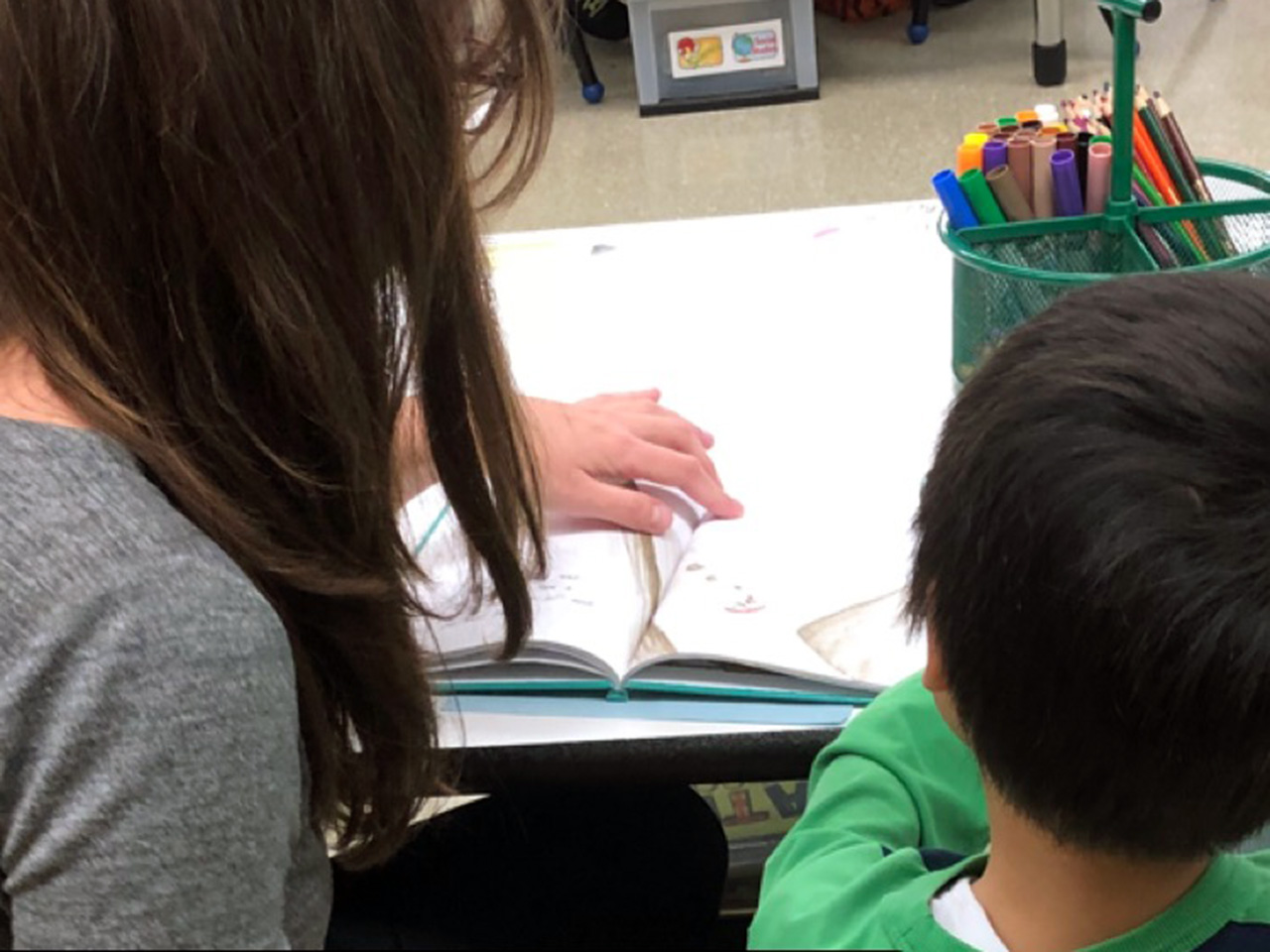 Woman and boy reading together